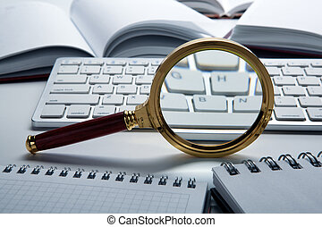 magnifying glass on the pc keyboard search technology concept