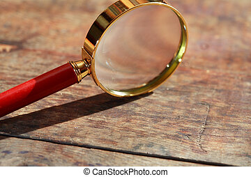Magnifying Glass On Wood
