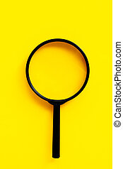 Magnifying glass on yello background.