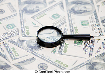 Magnifying glass on your american dollar bill as a background