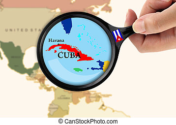 Magnifying glass over a map of Cuba