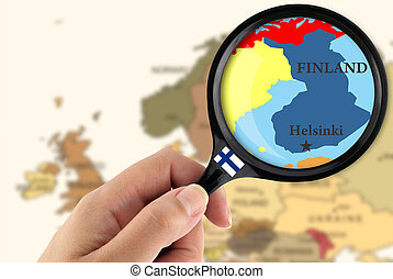 Magnifying glass over a map of  Finland