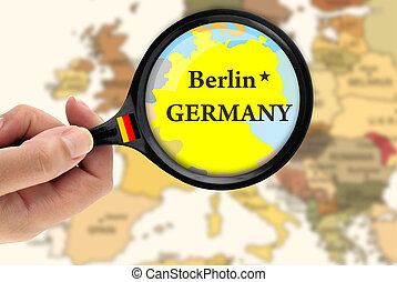 Magnifying glass over a map of Germany