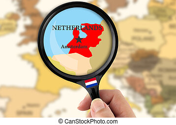 Magnifying glass over a map of Netherlands