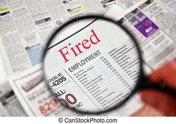 """Magnifying glass over a newspaper classified section with \""""Fired\"""" text"""