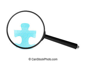magnifying glass searching for missing puzzle pieces