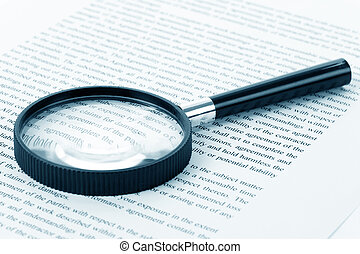 Magnifying Glass and document close up