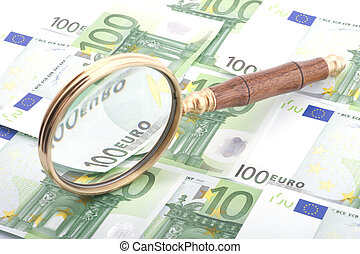 magnifying glass with money closeup
