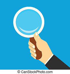 Magnifying icon in a hand