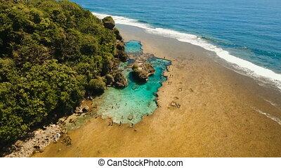 Magpupungko natural rock pools. Aerial view...