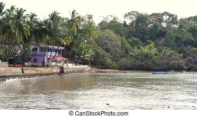 Blue house near the sea lagoon.