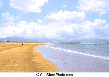 maharees golden beach shore - golden beach with blue sky and...
