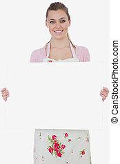Maid holding blank billboard