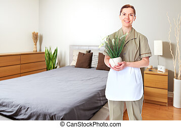 Maid woman with plant.