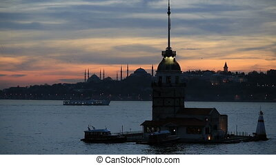 Maiden Tower and passenger ship at sunset time