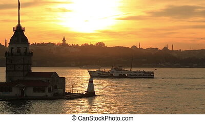 Maiden Tower and passenger ship at sunset time pan shoot