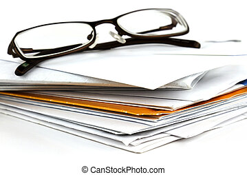 Mail and eyeglasses - Stack of postal mail with pair of...