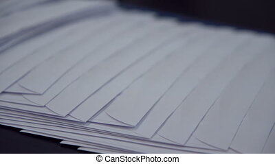 mail envelopes on factory - a lot of white postal envelopes...