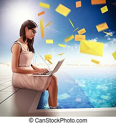 Mail on holidays - Businesswoman exchange mails with laptop...