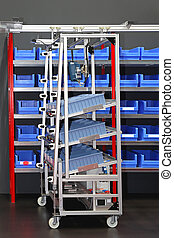 Mail order warehouse - Sorting bins and cart in mail order...
