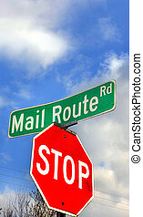 Mail Route Sign - Low angle shot of road sign leaves plenty...