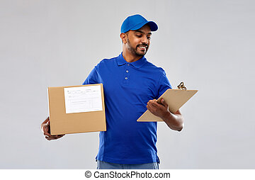 indian delivery man with parcel box and clipboard