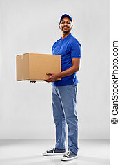 happy indian delivery man with parcel box in blue