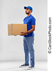 indian delivery man with parcel box in blue