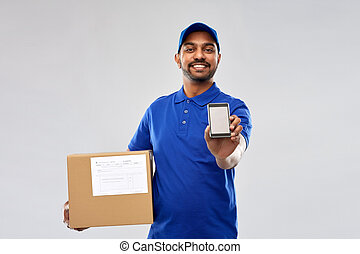 indian delivery man with smartphone and parcel box