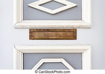 Mail slot in wood door