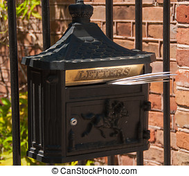 Mailbox - A photograph of a mailbox, a type that is seldom...