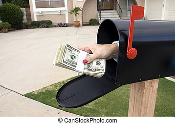 Mailbox and bundle of cash - A bundle of cash is being...