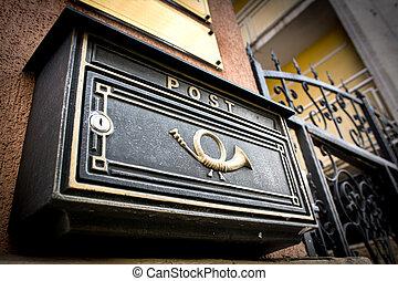 Mailbox - Black vintage mailbox with post written on it.