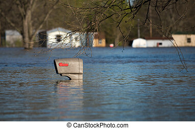 Mailbox in flood water - A mailbox is nearly covered by...
