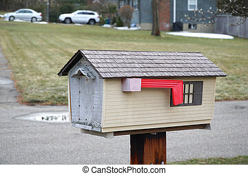 mailbox in house shape exterior in residential area