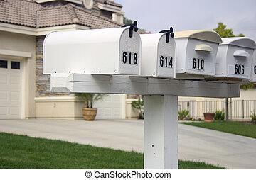 Mailbox Row - A row of mailboxes in a suburban neighborhood.