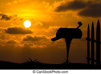 Mailbox silhouette with sunset background