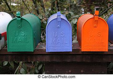 Mailbox Trio - A trio of colorful mailboxes.