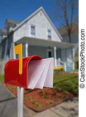 Mailbox with mail - A standard red mailbox american money...