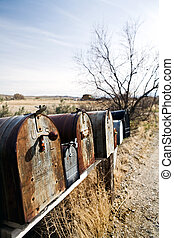 mailboxes in midwest United States, old vintage boxes in late sun rusting away