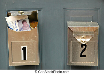 Mailboxes on a door