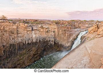 Main Augrabies waterfall at sunset