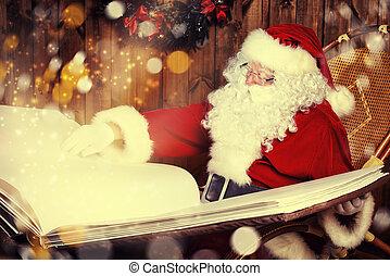 main book - Santa Claus reading magic book in his wooden...