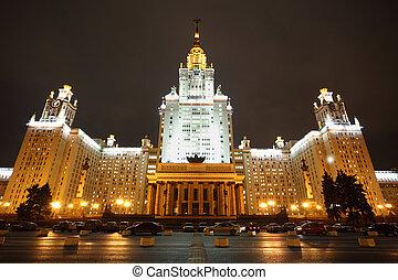 Main building of Lomonosov Moscow State University. Fall. Evening. Cars near building.