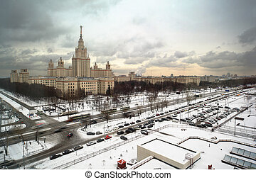 Main building of Moscow State University at winter in Moscow, Russia, view through window