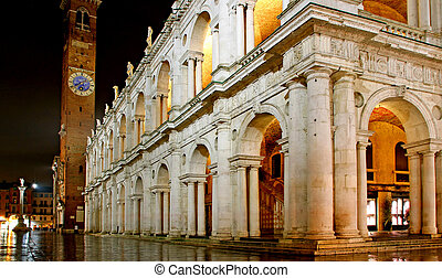 Main city square and palladian basilica with tower at night...