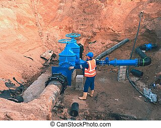 Main City water supply pipeline. Technical staff in...