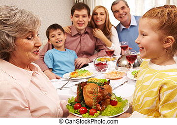Main coarse - Senior woman with cooked turkey looking at her...
