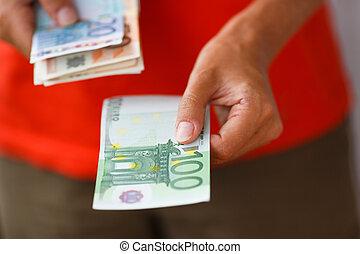 main, de, homme, argent donnant