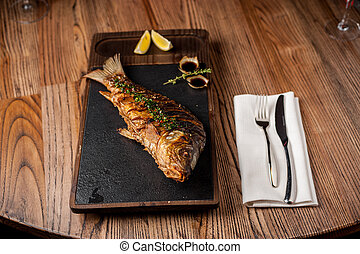 main dish in the restaurant. fried trout